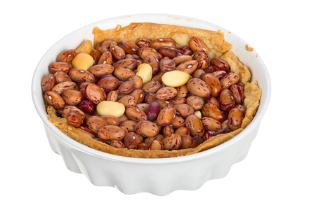 focus stacking: Handmade quiche in a small baking dish isolated on white background.