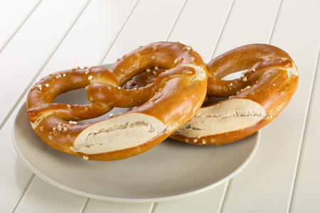 hardboard: A pretzel is a type of baked bread product made from dough most commonly shaped into a knot.