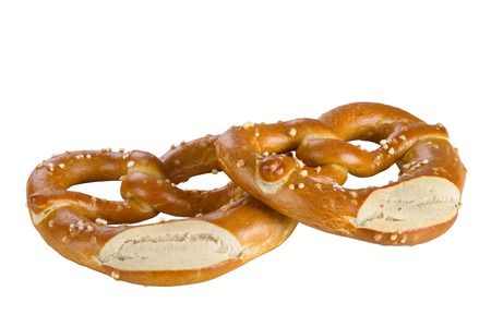 focus stacking: A pretzel is a type of baked bread product made from dough most commonly shaped into a knot, isolated on white background. Stock Photo