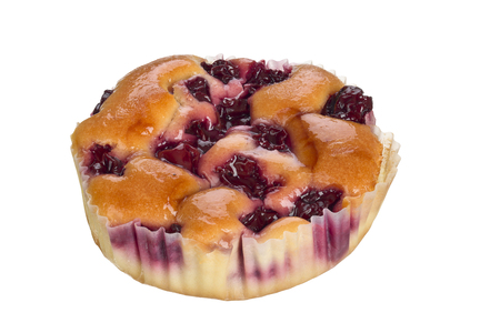 small cake: Small cake with cherry fruits isolated on white background.