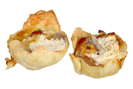 Handmade mini quiche isolated on white background.
