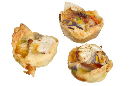 focus stacking: Handmade mini quiche isolated on white background.