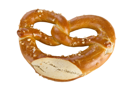 A pretzel is a type of baked bread product made from dough most commonly shaped into a knot, isolated on white background. Stock Photo