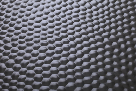 Black pressed steel plate as background , focus fusion. Stock Photo
