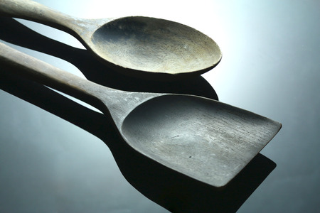 low key lighting: Two wood spoon on the table in low key lighting style.