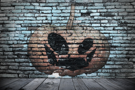 brick texture: Halloween wall  in the dark. pumpkin painting on the brick wall for horror content and Halloween festival.