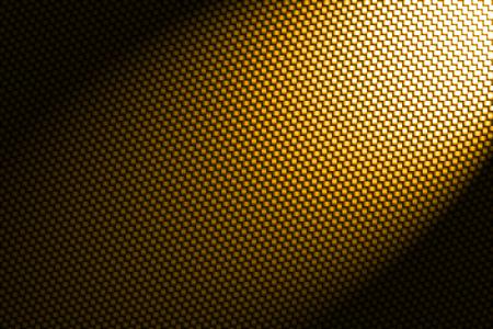 fibra de carbono: punto de mira en el fondo de fibra de carbono amarilla. Foto de archivo