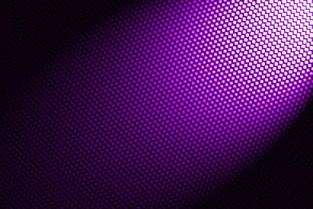 carbon fiber: spotlight on purple carbon fiber background. Stock Photo