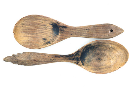 cooking utensil: two old wooden spoon on isolated background.