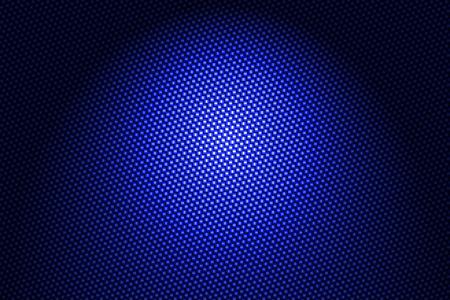 青い炭素繊維の背景にスポット ライトします。