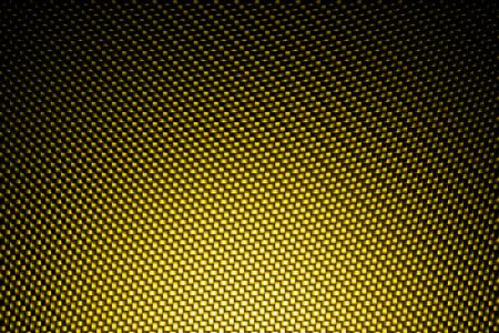 carbon fiber: punto de mira en el fondo de fibra de carbono amarilla. Foto de archivo