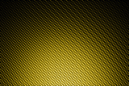 carbon fiber: spotlight on yellow carbon fiber background.