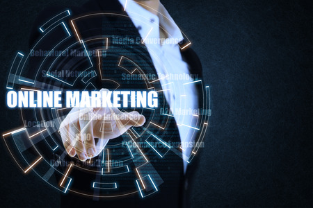 semantic: The businessman pointing the blue and orange circle of light by focusing on strategy of online marketing. This picture suitable for business and technology use. Stock Photo