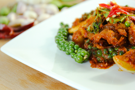 catfish: thai curry and garnish on the table. thai food.