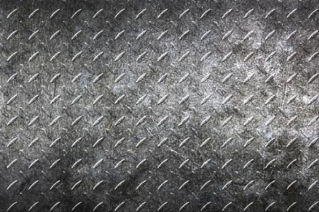 diamondplate: grunge diamond plate. dirty black metal background and texture. 3d illustration.
