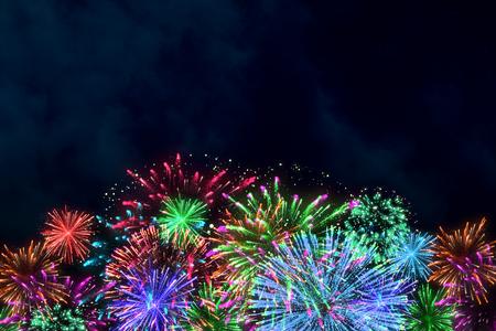 colorful firework on midnight blue sky for celebration content. background design. illustration.