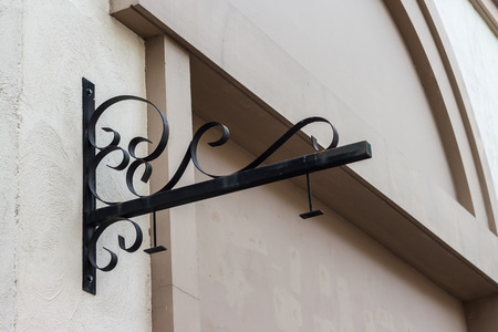 bracket: wrought iron for sign hanging bracket on a wall Stock Photo