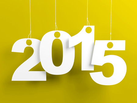 New year 2015 tags hanging on strings on yellow background