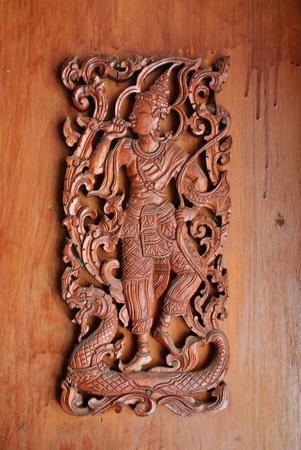 woodcraft: Carving man in wooden lanna style at lumpoon Stock Photo