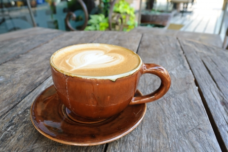 stone cold: Hot late at chiangmai on wooden backgroud