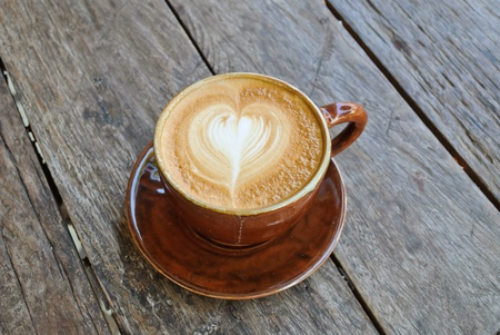 capuccino: Hot late at chiangmai on wooden backgroud