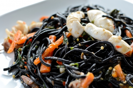 Spicy black spaghetti with prawns and squid photo