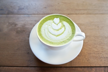 latte: Matcha green tea latte on wood table