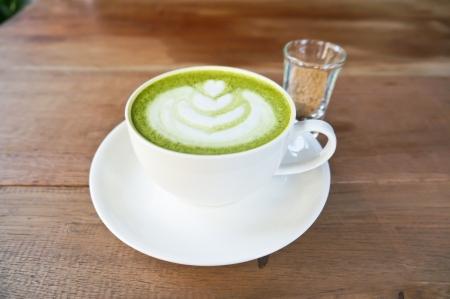matcha: Matcha green tea latte on wood table