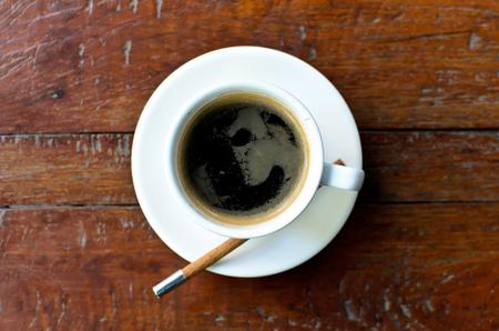 americano: A cup hot americano coffe  on wood table