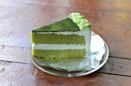 green drink powder: Green tea cake on wood table