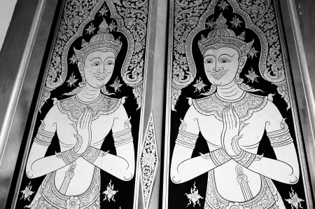 salutation: Salutation and smile are thai style that was painted on the door of thai temple