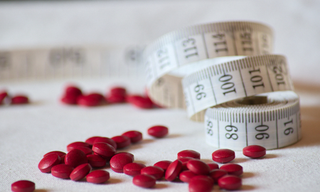 Drug and tape measure waist. 写真素材