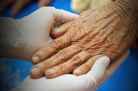 Nurse take care elderly patient. 写真素材