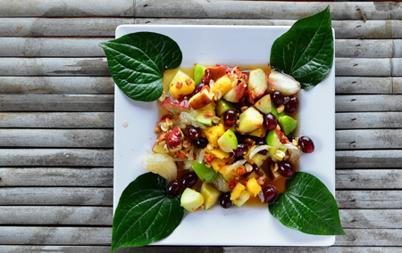 Papaya salad fruit on bamboo table.