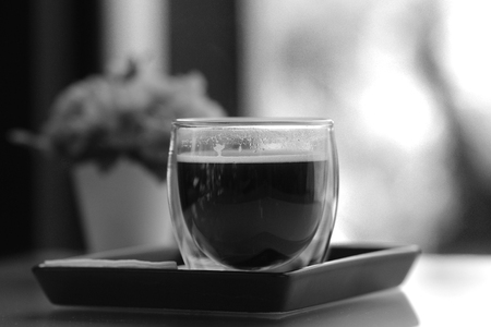 A cup of black coffee over wooden table. Stock Photo