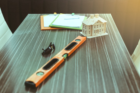 Business people working together on a building and home project with tools, wood swatches