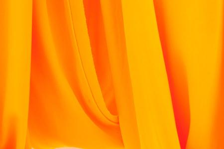 monk robe: crumpled yellow monk robe.