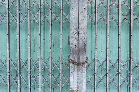 metal door: green folding metal door