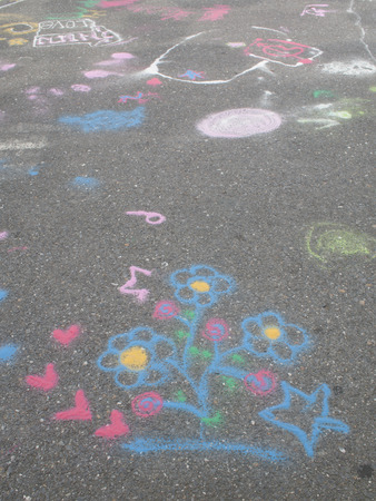 chalks: Colored chalks. Colored chalk on playground with drawings on street