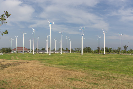 A View of Solar Panels and Wind Turbine in the Field at Chang-Hua-Mun, Royal Initiative Project, Huahin Thailand. photo
