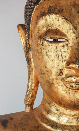 buddha face: Closeup of the face of buddhas image covering with gold leaf. Stock Photo