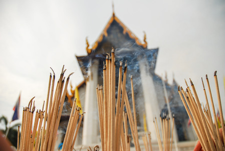 temple burn: joss sticks at temple in Thailand