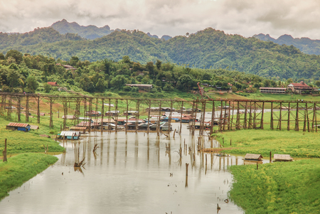 derrumbe: The old wooden bridge Bridge collapse Bridge across the river and Wood bridge (Mon bridge)at sangklaburi, kanchanaburi, Province Asia thailand Foto de archivo