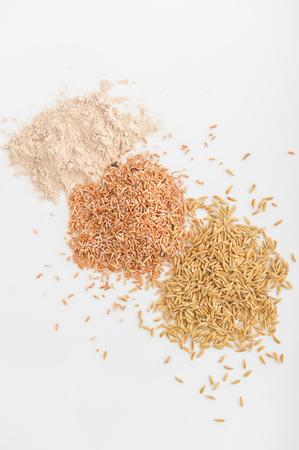 basmati rice: Three variety of rice: wild rice, red rice, and white rice. Shallow DOF