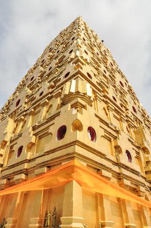 bodhgaya: Chedi Buddhakhaya, built to mimic the Mahabodhi stupa of Bodhgaya in India, is a symbol of Sangklaburi, Kanchanaburi, Thailand. It has many small metal Buddha images placed amid the corn-dob exterior.