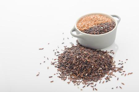 food staple: Three variety of rice: wild rice, red rice, and white rice. Shallow DOF