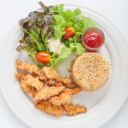 Fried chicken and garlic fried rice on the white plate Stock Photo
