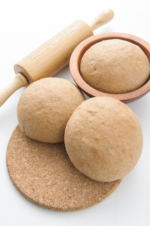 bap: Wholewheat bread rolls on white background
