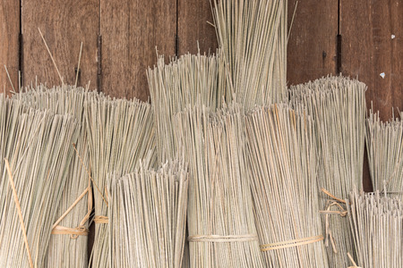 bundled: Bulrushes (Lepironia Articulata) are bundled and left to dry under the sun before using as a material for handicraft products e.g. bags and mats.