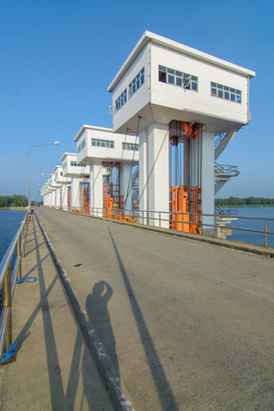 specifically: Uthokawiphatprasit watergate, Pak Phanang Diversion Dam Project is a project specifically approved by His Majesty the King of Thailand. Stock Photo